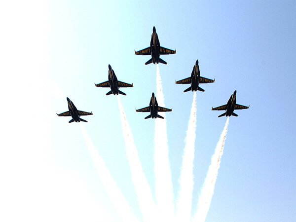 Military jets flying in formation to symbolize students' soaring achievement